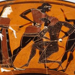 Theseus and the Minotaur on a terracotta kylix in the collections of the Met Museum. Ariadne stands behind Theseus, who is killing the Minotaur.